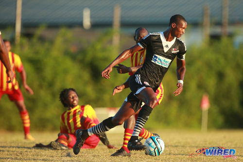 Photo: Central FC attacker Ataulla Guerra (right) turns on the style against Point Fortin Civic at the Mahaica Oval. (Courtesy Allan V Crane/Wired868)