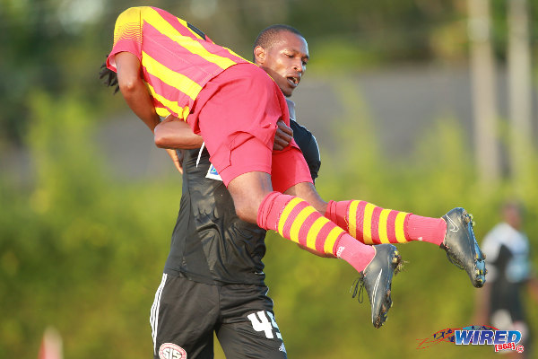 Photo: Take away? Central FC star Ataulla Guerra (standing) bodily lifted Point Fortin Civic playmaker Andre Toussaint and threw him over his shoulder during yesterday's Pro League contest in Mahaica Oval. (Courtesy Allan V Crane/Wired868)