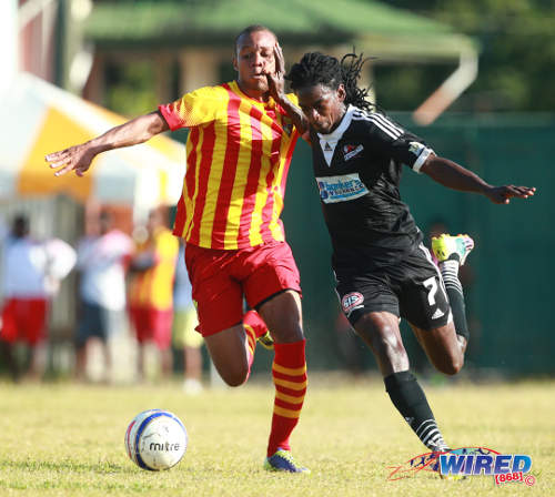 Photo: Central FC midfielder Jason Marcano (right) holds off Point Fortin Civic player Trent Lougheed at the Mahaica Oval. (Courtesy Allan V Crane/Wired868)