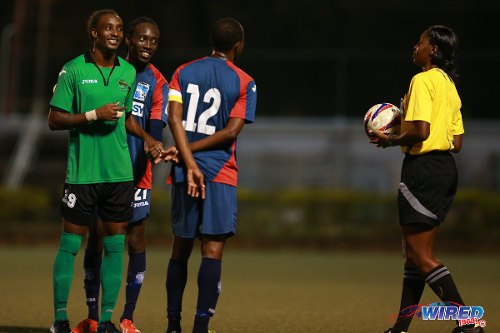 Photo: (From left) San Juan Jabloteh's Tyrone Charles, Caledonia AIA's Nathan Lewis and Kareem Joseph await the verdict of match referee Tricia Des Vignes during Pro League action. (Courtesy Allan V Crane/Wired868)
