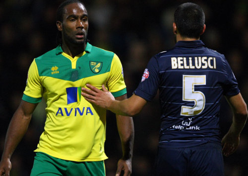 Photo: Norwich City striker Cameron Jerome (left) and Leeds defender Giuseppe Bellusci are cool now. Bellusci only wanted to punch him. (Courtesy UK Guardian)