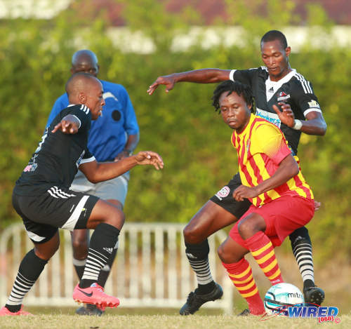 Photo: Point Fortin Civic veteran playmaker Andre Toussaint (centre) tries to glide away from Central FC players Ataulla Guerra (right) and Leston Paul. (Courtesy Allan V Crane/Wired868)