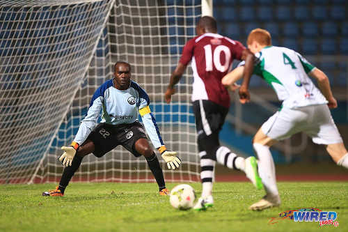Photo: W Connection goalkeeper Aquelius Sylvester (left) and defender Bradley Beaumont (right) combine to keep out North East Stars attacker Keron Cummings during the 2015 TTFA FA Trophy final. (Courtesy Allan V Crane/Wired868)