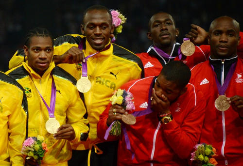 Photo: Jamaica and Trinidad and Tobago sprinters (from left) Yohan Blake, Usain Bolt, Keston Bledman, Marc Burns and Emmanuel Callender show off their gold and bronze medals respectively after the 4x100 final in London 2012. (Copyright AFP 2015)