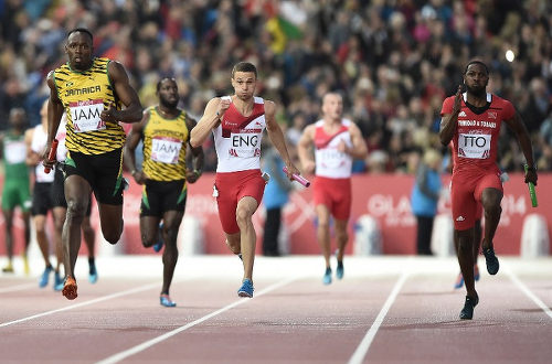 Photo: Trinidad and Tobago sprinter Richard Thompson (far right) chases Jamaican legend Usain Bolt (far right) during the London 2012 Olympics 4x100 metre final. (Copyright AFP 2015)