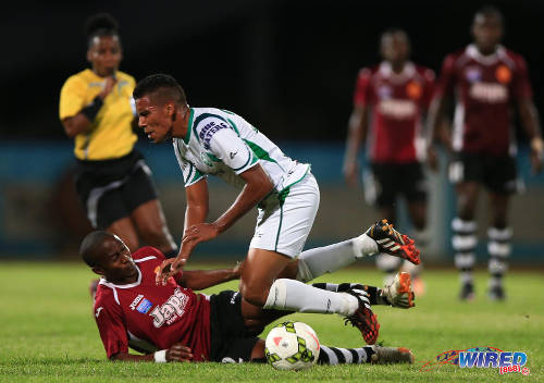 Photo: North East Stars substitute Jayson Joseph (left) lunges at W Connection midfielder Christian Rodriguez in front of referee Cecile Hinds (background) in the 2015 TTFA FA Trophy final. Joseph received a straight card for his tackle. (Courtesy Allan V Crane/Wired868)