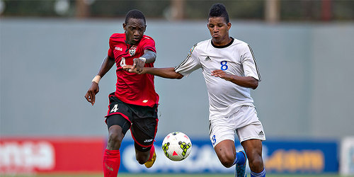 Photo: Trinidad and Tobago National Under-17 defender Tekay Hoyce (left) chases Cuba attacker Yosniel Gonzales. (Courtesy MexSport/CONCACAF)