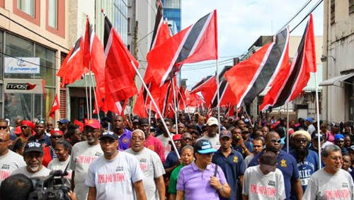 Photo: The Joint Trade Union Movement (JTUM) takes to the streets in protest against State corruption.