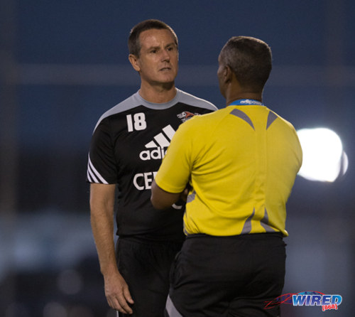 Photo: Welcome back! Central FC coach Terry Fenwick (left) was ordered out of the technical area by fourth official Rashby McPhie on his Pro League return against San Juan Jabloteh. (Courtesy Allan V Crane/Wired868)