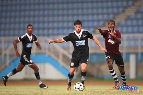 Photo: North East Stars midfielder Kaashif Thomas (right) tries to close down Central FC's Sean De Silva (centre) while Ataulla Guerra looks on. (Courtesy Allan V Crane/Wired868)