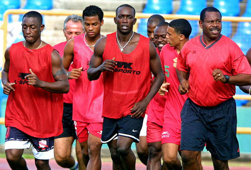 Photo: Trinidad and Tobago coach Zoran Vranes (second from left in background) trains with the National Football Team during the 2002 World Cup qualifying campaign. From left are: Russell Latapy, Brent Rahim, Dwight Yorke, Lyndon Andrews, Carlos Edwards and Wayne Lawson. (Copyright AFP2015/Juan Barreto)
