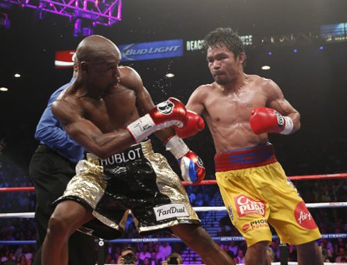 "Photo: Follow the Money! Manny ""Pacman"" Pacquaio (right) tries to keep up with welterweight boxing champion Floyd ""Money"" Mayweather. (Copyright John Gurzinski/AFP 2015)"