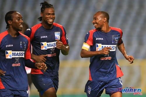 """Photo: Caledonia AIA captain Kareem """"Tiny"""" Joseph (right) celebrates his successful penalty kick with teammates Jamil Joseph (centre) and Nathan Lewis in the Digicel Pro Bowl final against Central FC. Caledonia AIA lost 4-1 at the Hasely Crawford Stadium. (Courtesy Allan V Crane/Wired868)"""