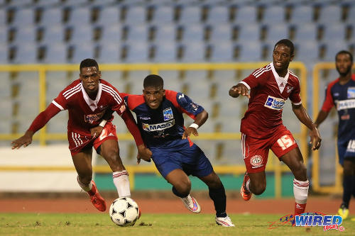 Photo: Caledonia AIA full back Jameel Neptune (centre) is a handful for Central FC defenders Elton John (left) and Kaydion Gabriel in the 2015 Digicel Pro Bowl final. (Courtesy Allan V Crane/Wired868)