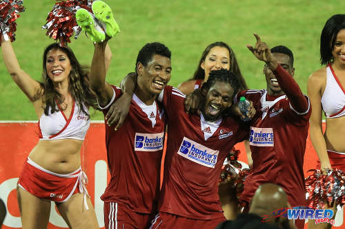 Photo: Central FC players (from left) Willis Plaza, Jason Marcano and Elton John celebrate after securing the Digicel Pro Bowl crown last night with a 4-1 win over Caledonia AIA at the Hasely Crawford Stadium, Port of Spain. (Courtesy Allan V Crane/Wired868)