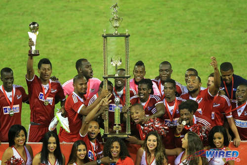 Photo: Central FC celebrate with the 2015 Digicel Pro League trophy after their 4-1 win over Caledonia AIA. (Courtesy Allan V Crane/Wired868)
