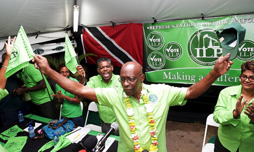 "Photo: King in his castle. ILP political leader Jack Warner gets ""rock star"" treatment at a cottage meeting after his release on bail."