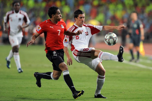Photo: Trinidad and Tobago midfielder Sean De Silva (right) tries to flick the ball over Egypt's Ali Mohammed during the Egypt 2009 Under-20 World Cup. (Copyright Khaled Desouki/AFP 2015)
