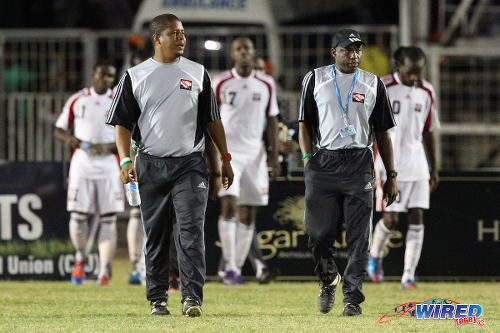 "Photo: Trinidad and Tobago National Senior Team assistant coaches Derek King (left) and Hutson ""Barber"" Charles leave the field after the 2012 Caribbean Cup final. (Courtesy Allan V Crane/Wired868)"