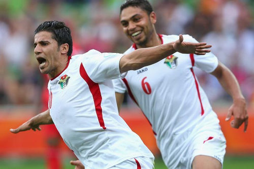 Photo: Jordan attacker Hamza Al Dardour (left) celebrates with a teammate during a previous international fixture.