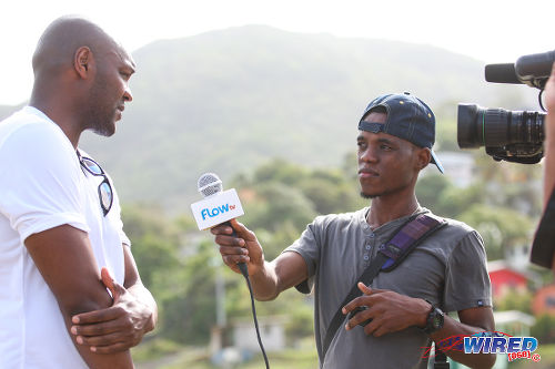 Photo: Football legend Marcus Gayle (left) speaks to Wired868 reporter Roneil Walcott during the Flow Legends Community Legacy Outreach programme at Speyside Recreation Grounds, Tobago. (Courtesy Allan V Crane/Wired868)