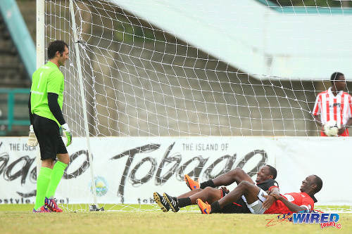Photo: Manchester United goalkeeper Raimond Van der Gouw (left) sees the lighter side of things after teammate Dwight Yorke (right) fails to stop Caribbean All Star playmaker Russell Latapy in the British Airways Tobago Legend semifinals. (Courtesy Allan V Crane/Wired868)