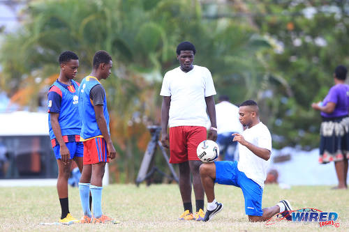 Photo: Kieron Forde displays his skills during the Flow Legends Community Legacy Outreach programme at Speyside Recreational Grounds, Tobago. (Courtesy Allan V Crane/Wired868)