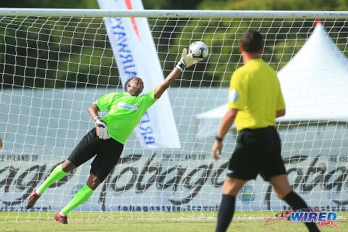 Photo: PFA All Star goalkeeper Shaka Hislop tries to keep out a shot against Liverpool in the BA Tobago Football Legends tournament. (Courtesy Allan V Crane/Wired868)