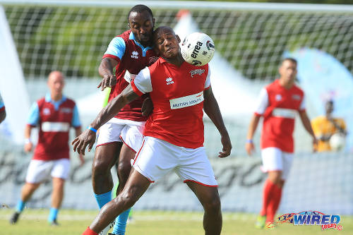 Photo: Aston Villa's Darius Vassell (left) tries to barge Arsenal's Luis Boa Morte off the ball in the BA Tobago Legends Football Challenge. (Courtesy Allan V Crane/Wired868)