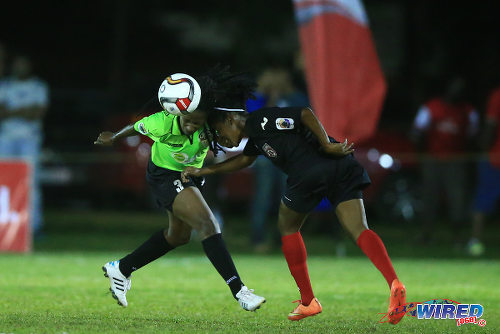 Photo: Rush defender Adeka Spence and Oilers winger Shenelle Henry contest the ball during WPL action in St James. (Courtesy Allan V Crane/Wired868)