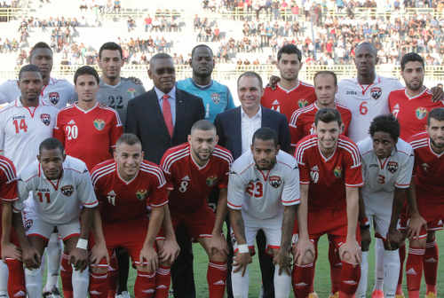 Photo: Jordan Prince Ali bin Hussein and Trinidad and Tobago Football Association (TTFA) president Raymond Tim Kee pose before kick off with the Jordan and Trinidad and Tobago football teams. (Courtesy TTFA Media)