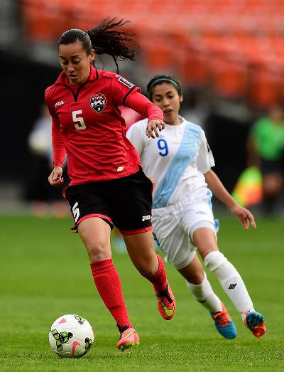 Photo: Trinidad and Tobago defender and 2014 Player of the Year Arin King (left) in action against Guatemala during the 2014 CONCACAF Championship. (Copyright Patrick McDermott/AFP 2015)