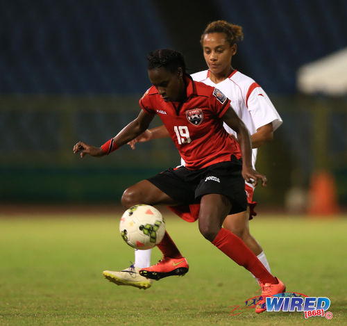 Photo: Trinidad and Tobago National Women's Team star Kennya Cordner (left) keeps the ball from a Women's Premier League (WPL) defender during a scrimmage match. (Courtesy Allan V Crane/Wired868)