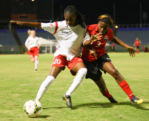 Photo: Trinidad and Tobago striker Mariah Shade (right) challenges Jamaican player Jodi-Ann McGregor during a scrimmage. (Courtesy Allan V Crane/Wired868)