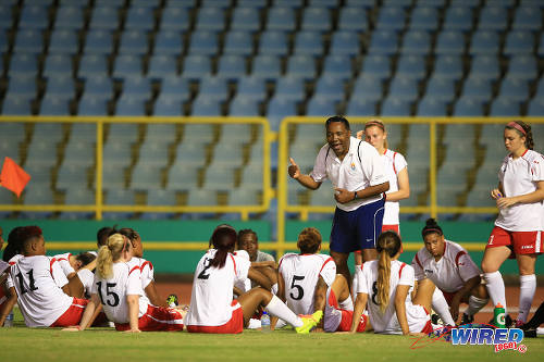 "Photo: Women's Premier League (WPL) coach Derek Arneaud (centre) talks to his combined squad, during a scrimmage against the ""Women Soca Warriors.) (Courtesy Allan V. Crane/Wired868)"