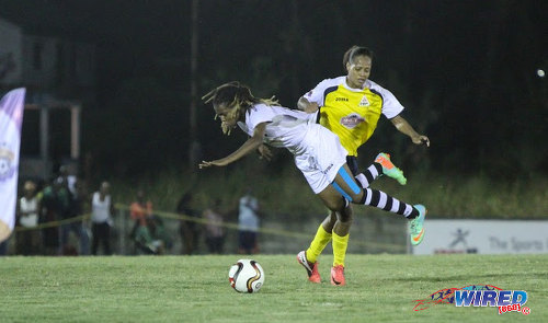 Photo: Angels attacker Kandace Franklin (left) is taken out by a Fuego defender during WPL action last night in Diego Martin. (Courtesy Sinead Peters/Wired868)