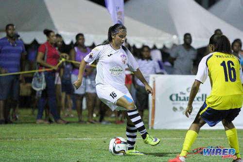 Photo: Angels attacker Vargas (left) takes on Fuego left back Tanesia Vassell during WPL action. (Courtesy Sinead Peters/Wired868)