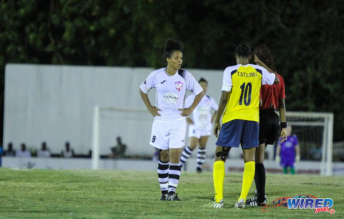 Photo: Angels captain Maylee Attin-Johnson (left) and Fuego skipper Tasha St Louis (centre) vie for referee Crystal Sobers' attention in WPL action. (Courtesy Sinead Peters/Wired868)
