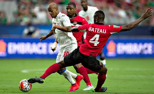 Photo: Trinidad and Tobago defender Sheldon Bateau (right) tackles Cuba attacker Ariel Martinez (left) while teammate Andre Boucaud looks on during the July 2015 Gold Cup. (Courtesy CONCACAF)