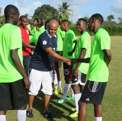 Photo: Trinidad and Tobago scout Dion Sosa (centre) at a benefit match for deceased former national footballer Akeem Adams.