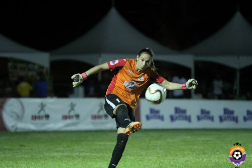 Photo: Fuego goalkeeper Lele clears the ball in WPL action against Rush in St James. (Courtesy Sinead Peters/WPL)