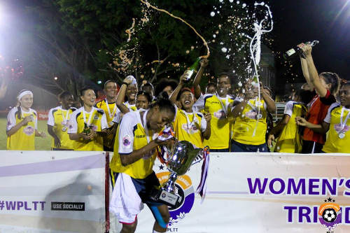 Photo: Fuego captain Tasha St Louis (front) and her teammates celebrate with the inaugural Women's Premier League (WPL) trophy in St James. (Courtesy Sinead Peters/WPL)