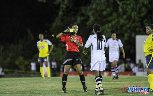Photo: Referee Crystal Sobers (centre) prepares to caution Angels midfielder Jodi-Ann McGregor. (Courtesy Sinead Peters/Wired868)