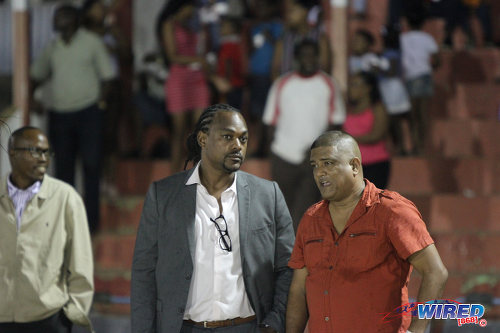 Photo: Former Sport Minister and Central FC chairman Brent Sancho (centre) watches WPL action in Sangre Grande with Japs Fried Chicken and North East Stars owner Darryl Mahabir. (Courtesy Sinead Peters/Wired868)