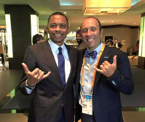 Photo: Trinidad and Tobago Olympic Committee (TTOC) president Brian Lewis (left) with a delegate at the 2015 Pan American Games in Toronto. (Courtesy TTOC)
