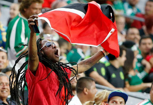 Photo: A Trinidad and Tobago football fan waves his flag during their 2015 CONCACAF Gold Cup fixture against Cuba in Phoenix. (Courtesy CONCACAF)