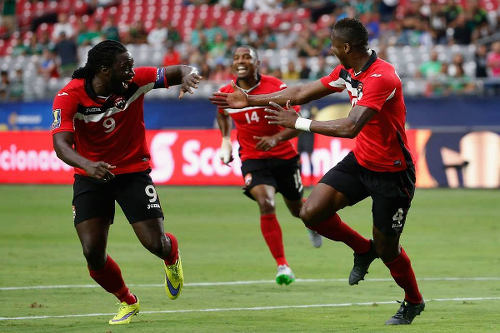 Photo: Trinidad and Tobago captain Kenwyne Jones (left) congratulates scorer Sheldon Bateau (right) after his 2015 Gold Cup goal against Cuba. Looking on is Andre Boucaud. (Courtesy CONCACAF)