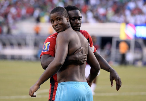 Photo: Trinidad and Tobago football captain Kenwyne Jones (background) hugs international teammate and Point Fortin Civic goalkeeper Marvin Phillip after their penalty shootout loss to Panama in the 2015 CONCACAF Gold Cup quarterfinal. (Copyright Jewel Samad/AFP 2015)