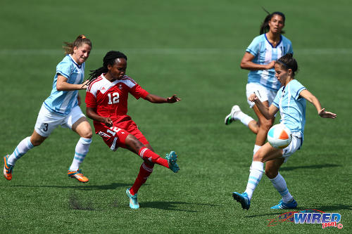 Photo: Trinidad and Tobago winger Ahkeela Mollon (centre) whips in a cross during their 2015 Pan Am contest with Argentina. The Trinidad and Tobago and Argentina teams played to a 2-2 draw. (Courtesy Allan V Crane/Wired868)
