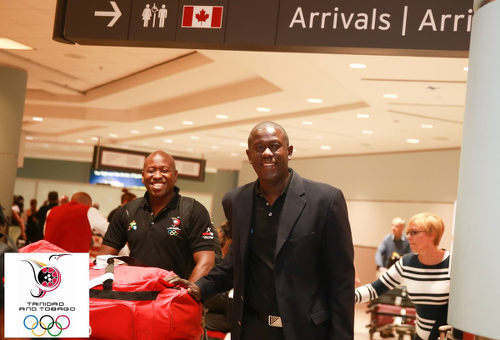Photo: North East Stars coach Ross Russell (right) touches down in Toronto for the July 2015 Pan American Games, during his stint as Trinidad and Tobago Women's National Senior Team head coach. (Copyright Allan V Crane/TTOC)